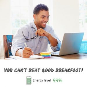 An energized man working happily due to a healthy breakfast